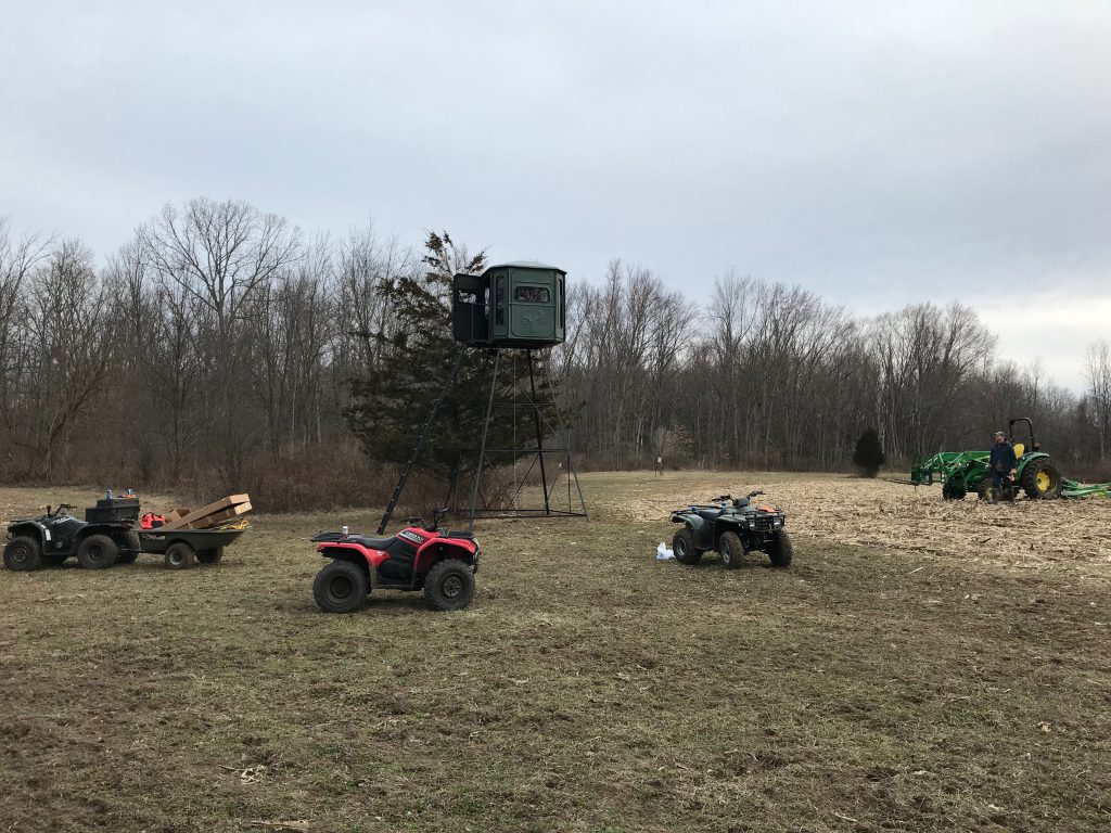 We used a tractor and 4 guys to raise this 15 ft blind.